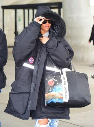 Rihanna spotted at JFK airport on October 28, 2016 big black coat