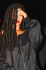 Rihanna arrives for a Halloween party at the Marquee New York on October 29, 2016 raised hand