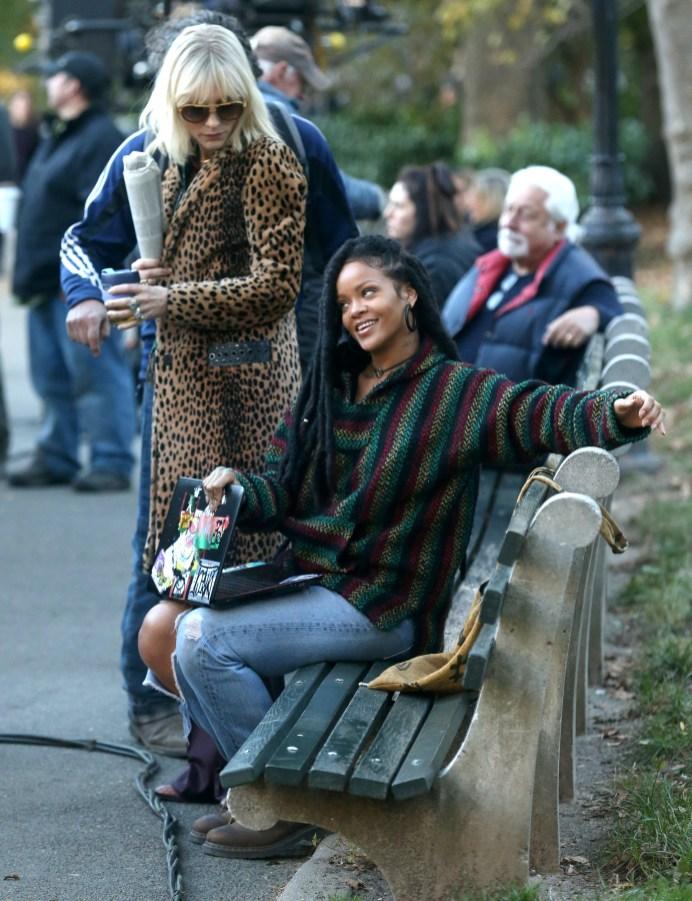 Rihanna, Cate Blanchett and Sandra Bullock on set of Ocean's Eight in New York on November 7, 2016 sitting on a bench