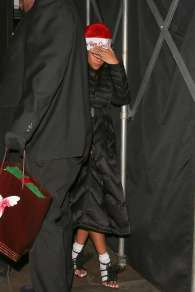 Rihanna throws the Fenty Corp Christmas party on December 19, 2016 in a big coat