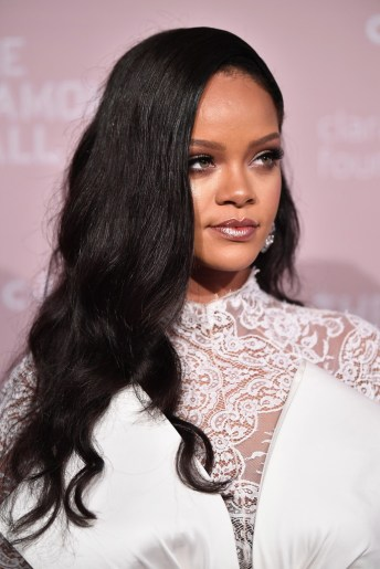 Rihanna attends 2018 Diamond Ball long black hair
