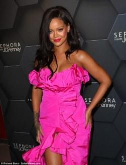 Rihanna at Fenty Beauty's anniversary party on September 14, 2018 posing