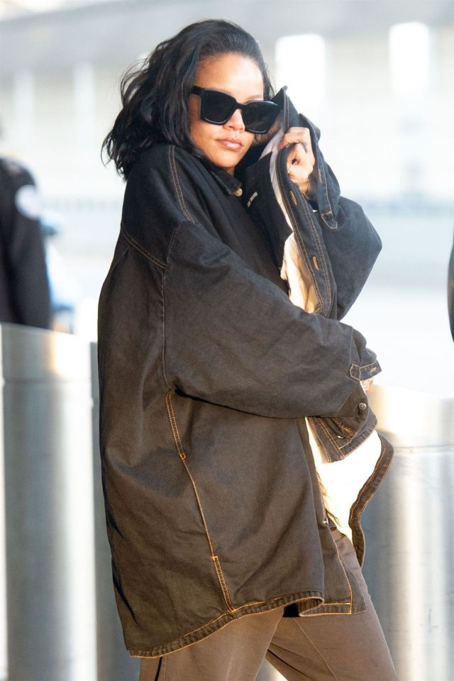 Rihanna arrives in New York at JFK Airport wearing Raf Simons January 28, 2019