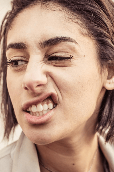 woman makes expression of disgust