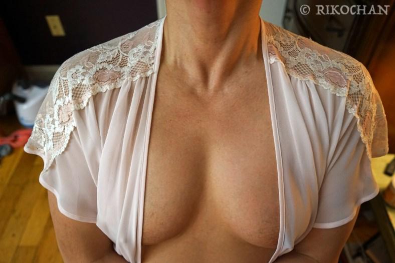 Muscular pecs in white lingerie