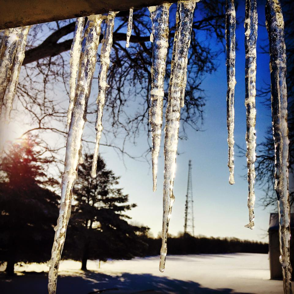 Long, thick icicles growing off of my back porch