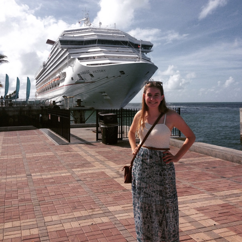 Riley stands in front of an enormous cruise ship in Key West
