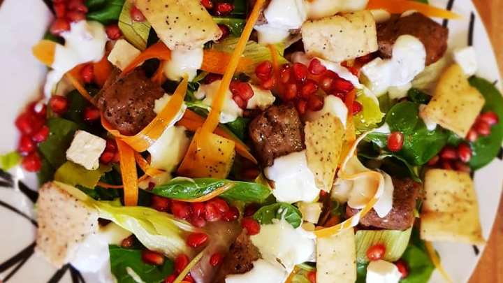 Minted Lamb kofte and pomegranate salad with garlic yogurt.
