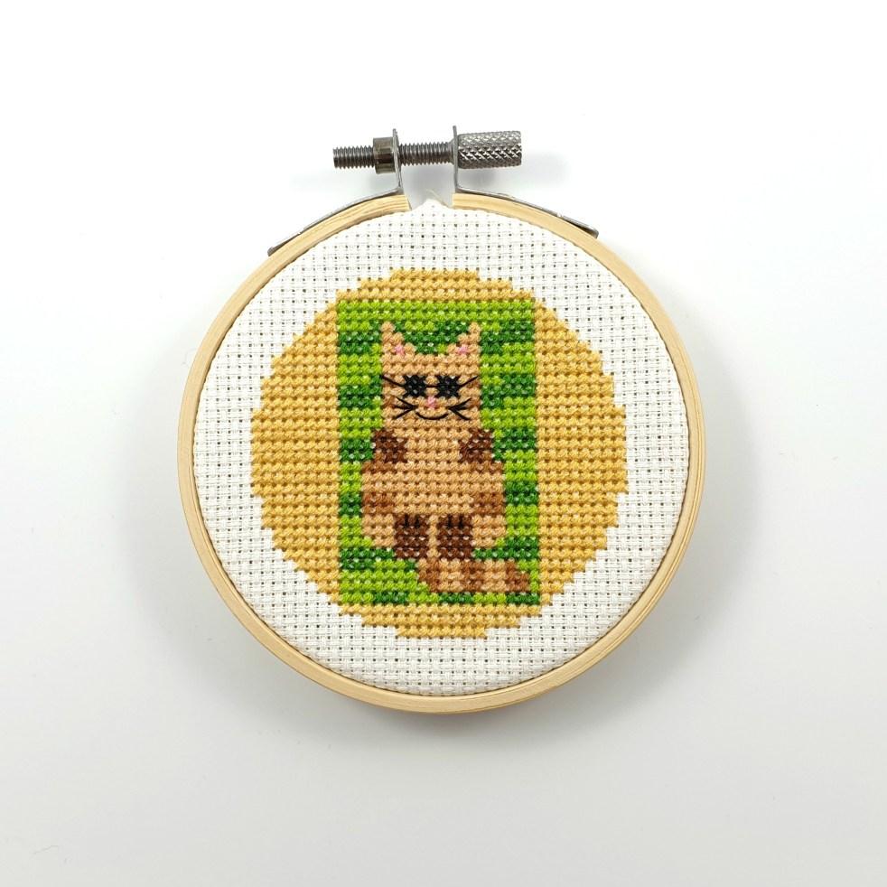 Cat on a beach towel cross stitch pdf pattern