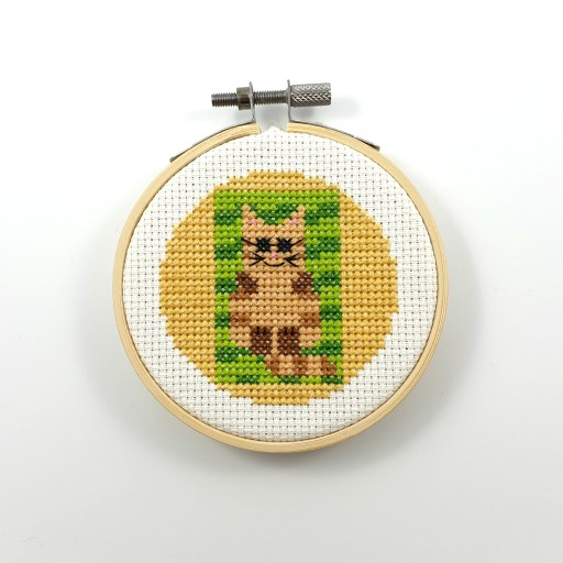 Cat on a beach towel cross stitch pdf pattern