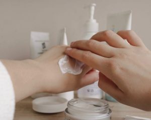 person using cream on hand