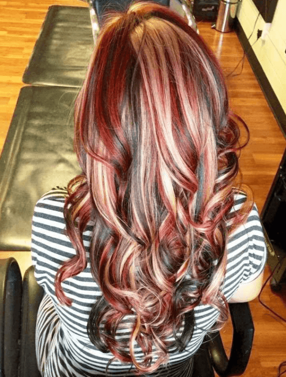Red hair with blonde and purple highlights