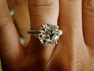 Round Brilliant Heirloom Engagement Ring With Baguettes