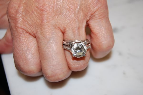 Round Brilliant Engagement Ring With Tapered Baguette Side