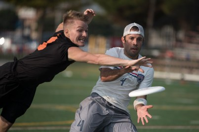 FRISCO, TX: JD Hastings (Ring of Fire #9) bids past Max Cook (Doublewide #4) - Pool Play - USA Ultimate Club National Championships. October 1, 2015. © Jolie J Lang for UltiPhotos