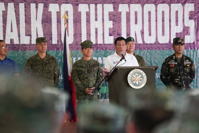 President Rodrigo Duterte talks to the troops of Joint Task Force Sulu prior to his visit to wounded soldiers at Camp Teodulfo Bautista in Jolo, Sulu on May 27, 2017. PCOO/Released
