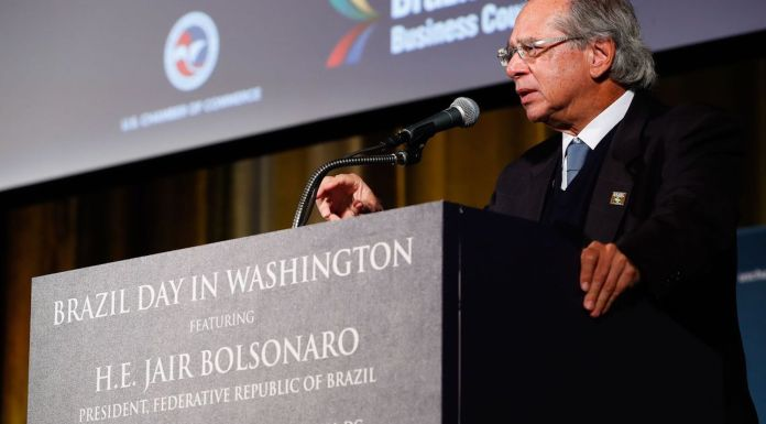 Economy Minister, Paulo Guedes, speaks to businessmen in Washington DC.