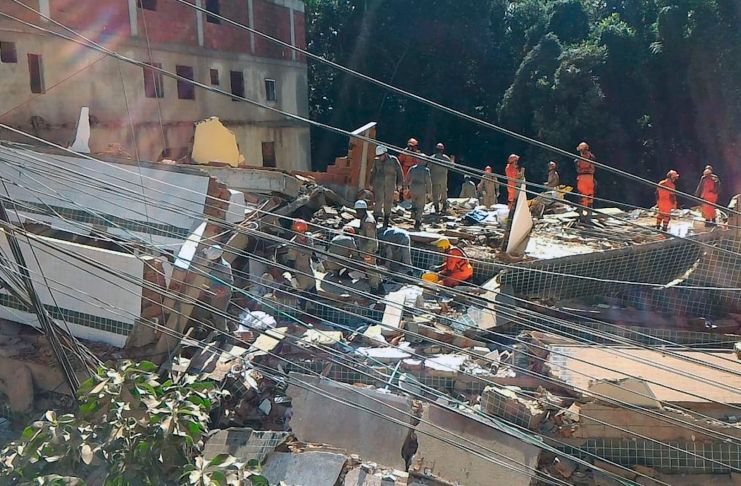Brazil, Rio de Janeiro,Firefighters look for survivors in Friday's collapse of two buildings in the Muzema community in Rio de Janeiro.