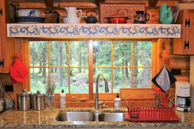 Rosemåling above the cabin sink
