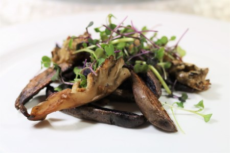 Roasted blue fingerling potatoes with Maitake mushrooms and microgreens