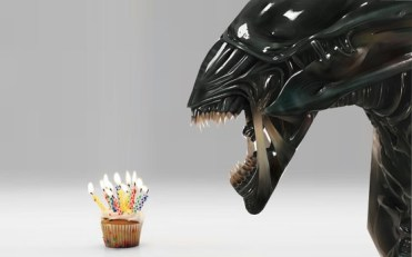 alien with birthday cupcake
