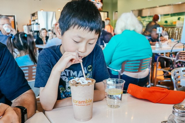 Where to eat breakfast in Tempe|Asian boy drinking a protein shake