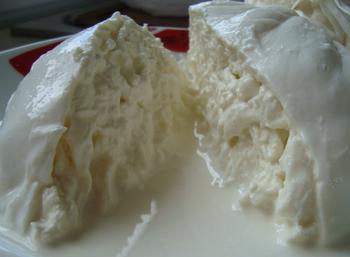 Burrata -- Italian fresh cheese made from mozzarella and cream