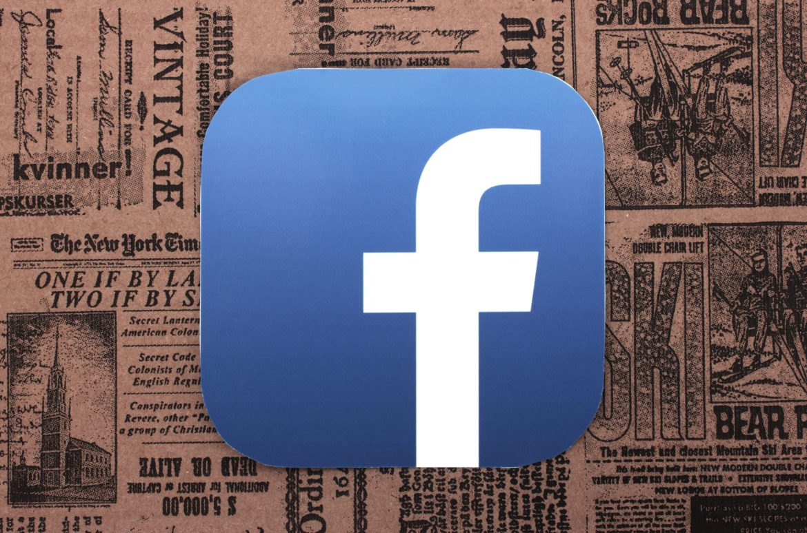 facebook logo in the foreground with vintage newspaper front pages in the background