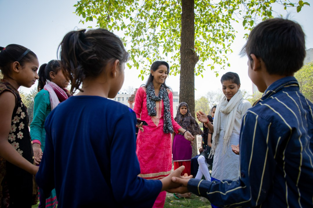 Khushboo, a Girl Icon in India, leads an educational game with kids from her community.