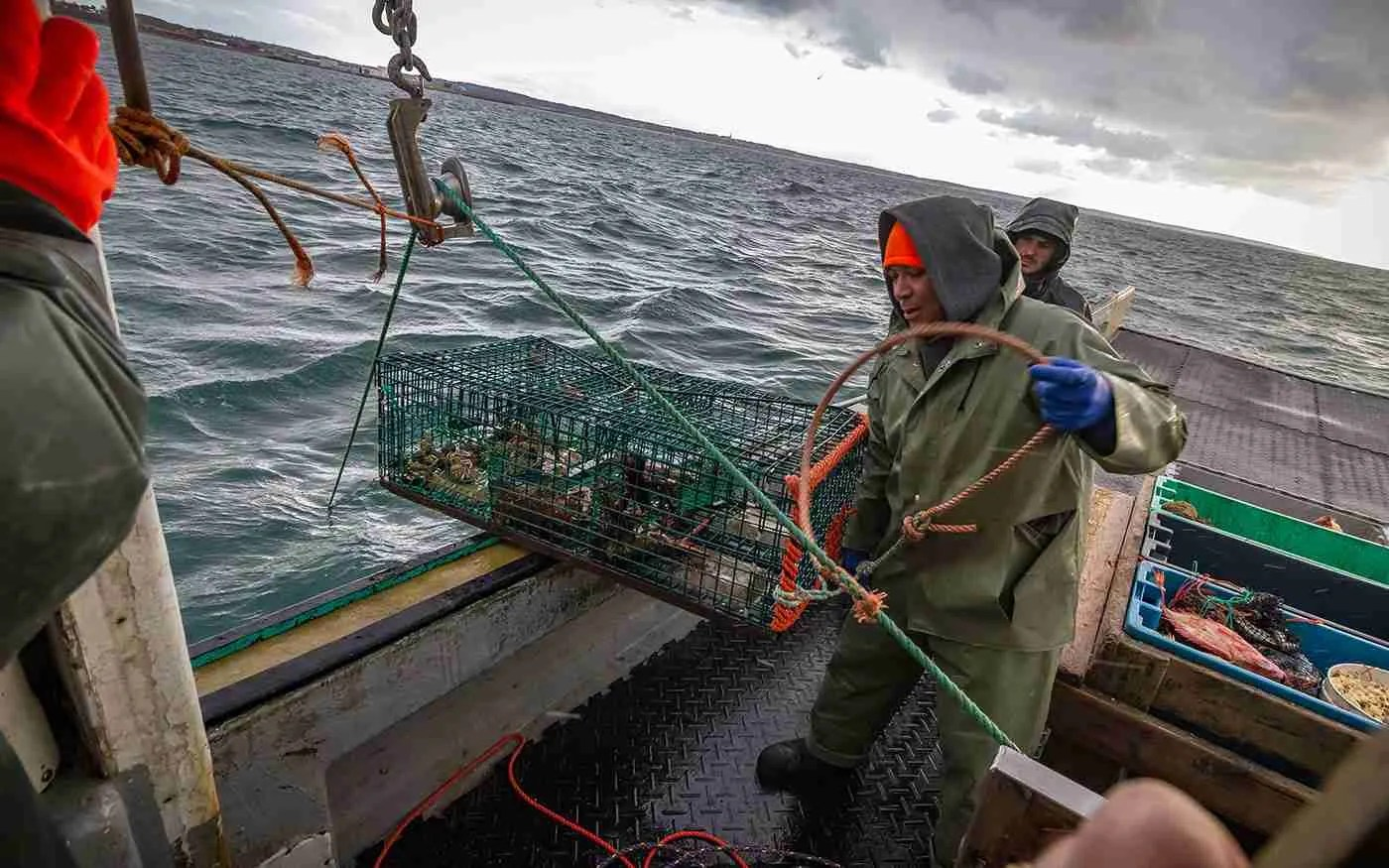 Fishermen from Indian Brook First Nation, Nova Scotia, checking lobster traps.