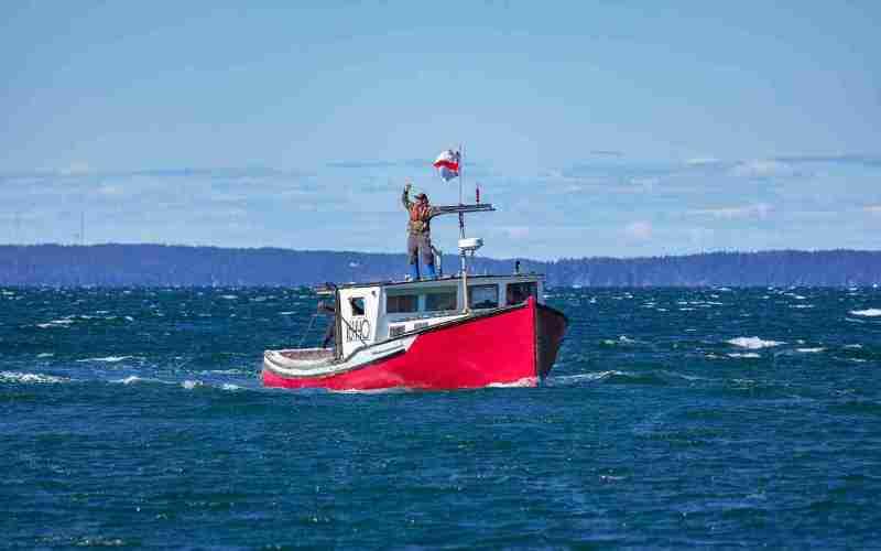 Sipekne'katik lobster fisherman on his boat.