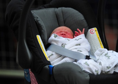 The Duchess of Cambridge's new-born baby boy seen in a car seat outside the Lindo Wing of St Mary's Hospital in London on July 23, 2013.