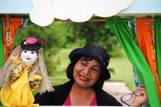 Everyone gathered to watch a puppet show created by one of Columbia's Iraqi refugees