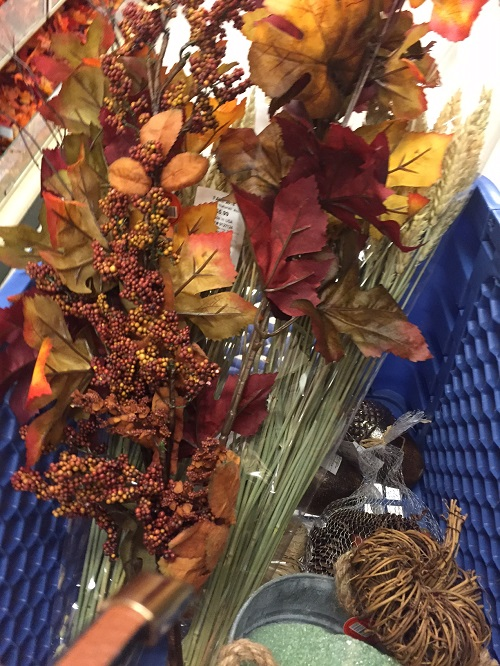 cart filled with fall decor from hobby lobby
