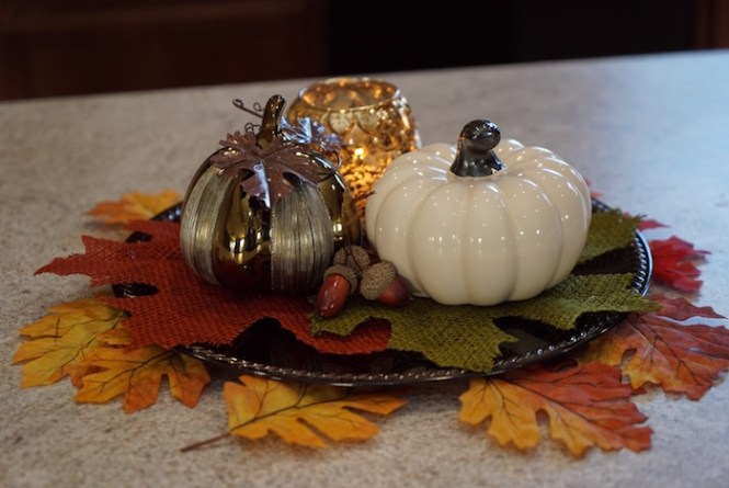 fall decor pumpkins with candle and foliage
