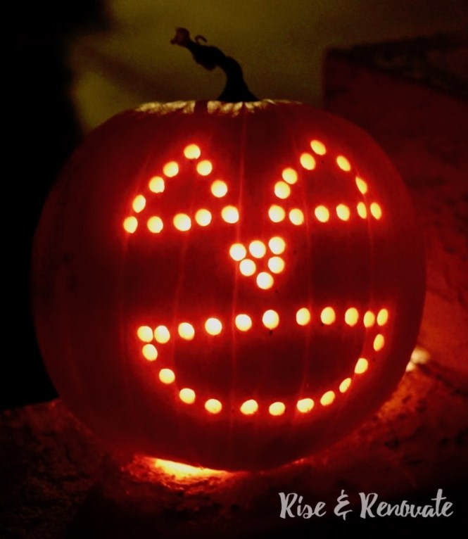 carving pumpkins with a power drill - night picture