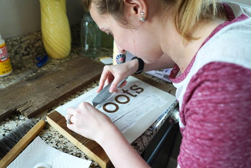Peeling Up Vinyl Layer - DIY Reclaimed Wood Sign