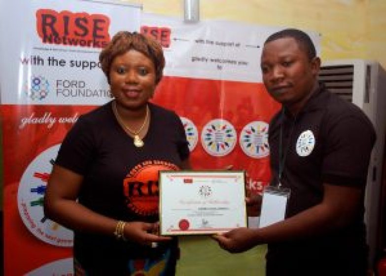 Rise Networks' Founder, Mrs. Toyosi Akerele-Ogunsiji presenting the Certificate of Fellowship to one of the Fellows. #NSLP2016