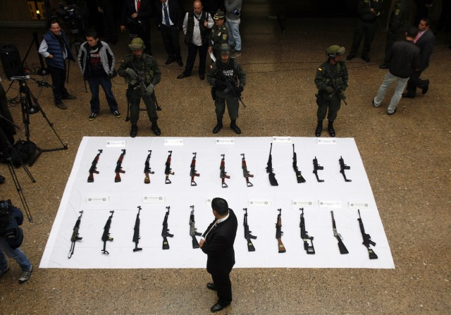A cache of FARC weapons collected by the government in 2013. Photo Credit: Policía Nacional de los colombianos/ Flickr (CC By 2.0)