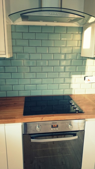Tiles and cooker