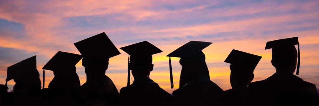 students wearing grad caps