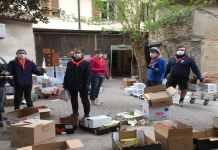 Gli scout alla sede Caritas