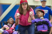 Chaney Roko, center, holds baseballs in the hands of her daughters Keira, left, and Mary, right, during a modified baseball game for handicapped children at the Webster Community Center on May 16, 2015 in Webster, N.Y. To keep her kids active, Chaney enrolls her daughters in various sports around the area year round.