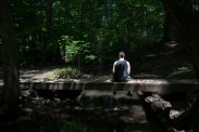Summary: Newlyweds, Tyler and Jessica Rinallo, experience many of the same challenges other couples face as they adjust to married life together. In addition to the simple changes, their lives are transforming in more complex ways as Tyler transitions from being a female to a male. Tyler Rinallo rests on a bridge at his favorite hiking spot on June 22, 2015 in West Irondequoit, N.Y. Tyler described this location as his peaceful place where he can just be himself.