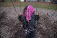 Nunu swings at the playground near a family friend's house in Batavia, N.Y., on Dec. 3, 2016.