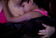 """Nunu lays with his mother at their home in Batavia, N.Y., on Dec. 11, 2016. Mrs. Schmieder is fully supportive of Nunu and the gender identity he feels most comfortable in, """"If he chooses to transition, he has my full support, and our family's support"""" she said."""