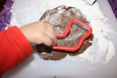 Cutting out gingerbread cookie stocking