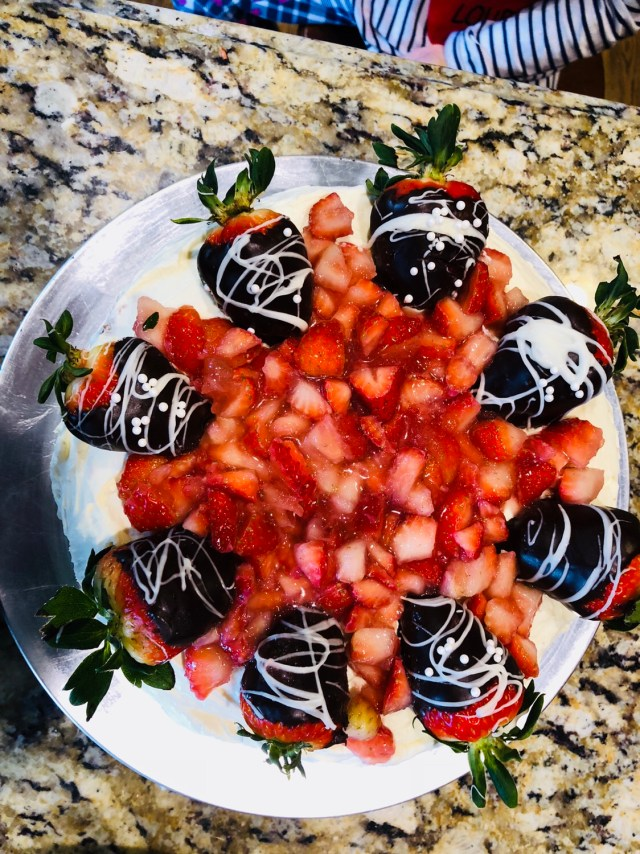 Add strawberry topping to cake