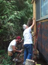 John and Curtis putting on siding boards