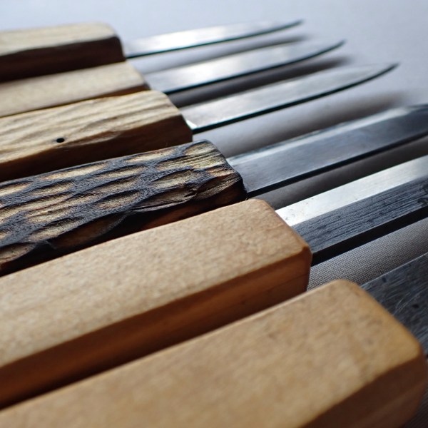 A selection of paring knives with hand-forged blades and hand-carved handles at RivenJoiner.com.